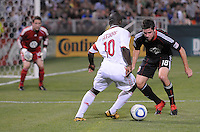 AC Milan midfielder Clarence Seedorf (10) challenges DC United Devon Mctavish (18) DC United defeated AC. Milan 3-2 at RFK Stadium, Wednesday May 26, 2010.