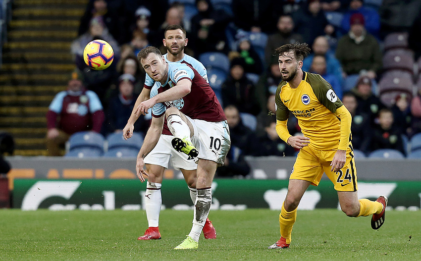 Burnley's Ashley Barnes clears despite the attentions of Brighton & Hove Albion's Davy Propper<br /> <br /> Photographer Rich Linley/CameraSport<br /> <br /> The Premier League - Burnley v Brighton and Hove Albion - Saturday 8th December 2018 - Turf Moor - Burnley<br /> <br /> World Copyright © 2018 CameraSport. All rights reserved. 43 Linden Ave. Countesthorpe. Leicester. England. LE8 5PG - Tel: +44 (0) 116 277 4147 - admin@camerasport.com - www.camerasport.com