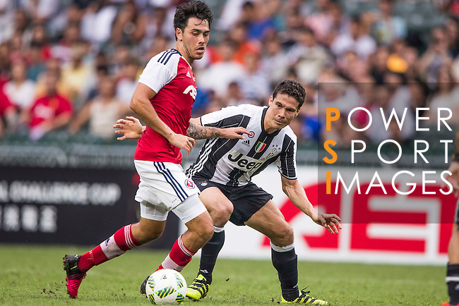 South China's player Sean Tse Ka Keung contests the ball against Juventus' player Anderson Hernanes de Carvalho Viana Lima during the South China vs Juventus match of the AET International Challenge Cup on 30 July 2016 at Hong Kong Stadium, in Hong Kong, China.  Photo by Marcio Machado / Power Sport Images