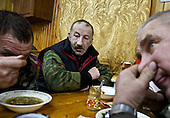 """Truck drivers at the oil and gas prospecting company """"Siesmorevzedka"""" eat together after work in the Arctic tundra. Typically, they work in the cold, isolated Arctic tundra for the entire winter, returning to civilisation only in spring."""