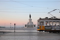Placa do Commercio or Commerce Square, Lisbon, Portugal, with a tram passing and the equestrian statue of King Jose I trampling on snakes, 1775, by Machado de Castro, looking out towards the Tagus river. The square was previously known as Terreiro do Paco or Palace Square as it was the site of the Pacos da Ribeira or Royal Ribeira Palace until it was destroyed in the 1755 earthquake. Picture by Manuel Cohen