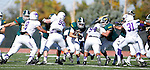 SPEARFISH, S.D. -- OCTOBER 1, 2016: Phydell Paris #34 of Black Hills State runs between blockers and toward New Mexico Highlands defenders during their game Saturday at Lyle Hare Stadium in Spearfish, S.D.  (Photo by Dick Carlson/Inertia)