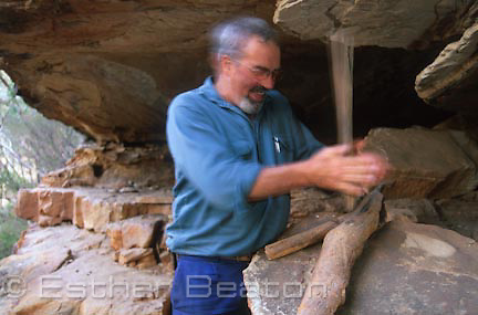 Milton Judd, demonstrating fire making with aboriginal artifacts found in rock shelter on his property, near Pilliga region of New South Wales