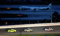 Jul. 5, 2008; Daytona Beach, FL, USA; NASCAR Sprint Cup Series driver Paul Menard (15) leads Dale Earnhardt Jr (88) and David Ragan (6) as a Hendrick Racing plane lands at a nearby airport during the Coke Zero 400 at Daytona International Speedway. Mandatory Credit: Mark J. Rebilas-