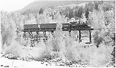 #340 with freight crossing the Mill Trestle in front of site of the Wanakah Mill.<br /> D&amp;RGW  Ouray Branch, CO  Taken by Maxwell, John W.