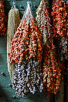 Drying peppers and eggplant adorn a rustic door within the Turkish Spice Market