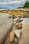 Deer Isle, Maine: Colorful rocks on the shoreline Jericho Bay