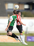 10 July 2014; Mark Timlin, Derry City, in action against Cledan Davies, Aberystwyth Town. UEFA Europa League First Qualifying Round, Second Leg, Aberystwyth Town v Derry City. Park Avenue, Aberystwth, Wales. Picture credit: Ian Cook / SPORTINGWALES