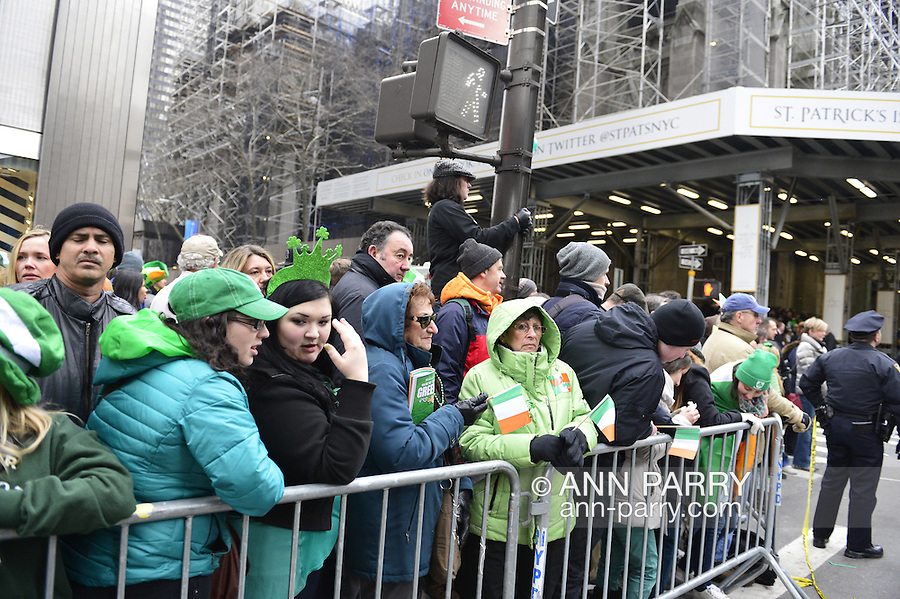 "March 16, 2013 - New York, NY, U.S. - Crowds line across the street of St. Patrick's Cathedral (right) at the 252nd annual NYC St. Patrick's Day Parade. Thousands of marchers show their Irish pride, as they march up Fifth Avenue, and over a million people, often in green and orange, watch and celebrate. Because St. Patrick's Cathedral is under construction, it had a sign announcing, ""ST. PATRICK'S IS OPEN.'"
