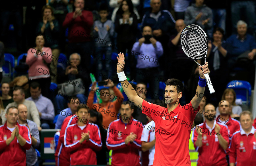 KRALJEVO, SERBIA - MARCH 06: Novak Djokovic of Serbia celebrates against  Mate Delic of Croatia after their men's single match on the day one of the Davis Cup match between Serbia and Croatia on March 06, 2015 in Kraljevo, Serbia. (Photo by Srdjan Stevanovic/Getty Images)