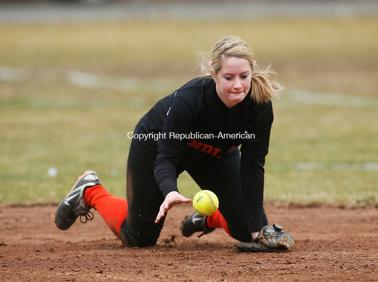Naugatuck, CT- 08 April 2015-040815CM13- Watertown's Kailyn Biello knocks the ball down before making a play to first during their NVL matchup against Naugatuck on Wednesday.   Christopher Massa Republican-American