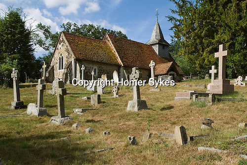 Pyrford Church of St Nicholas. Surrey England.  Built in 1140 and is a fine example of a complete Norman Church. St Nicolas was built on a circular hill top mound that points to very early pre-christian settlement.