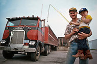 Kansas City, Missouri, September 9, 1978. Jim Shippy and his son Chris (4 years old) in front of his Freightliner, Jim is in cattle transport business,