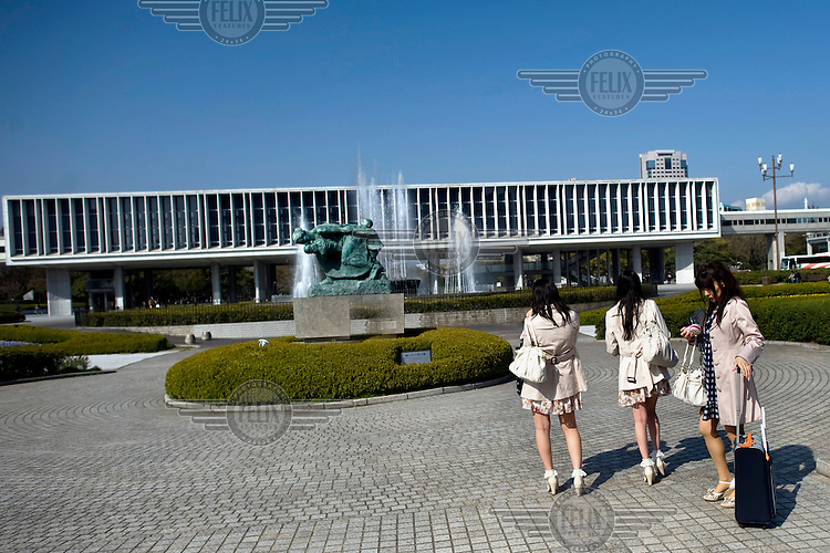 Three young women in front of the Atomic Bomb Museum. /Felix Features