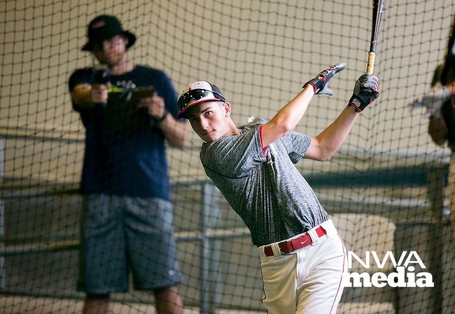 NWA Democrat-Gazette/JASON IVESTER --06/01/2015--<br /> Rogers Heritage's Logan Easley takes practice in the batting cages on Monday, June 1, 2015, inside Arvest Ballpark in Springdale.