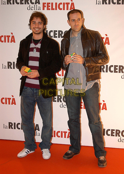 NICOLAS VAPORIDIS & ENRICO BRIZZI (?).The premiere of ''Pursuit Of Happyness'' at the Auditorium Conciliazione in Rome, Italy.. January 11th, 2007.full length black jacket brown leather rubik's cube jeans denim .CAP/CAV.©Luca Cavallari/Capital Pictures