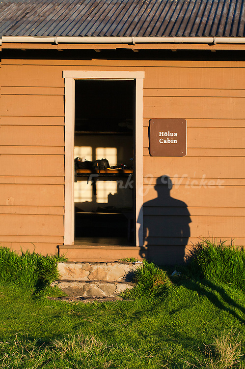 Sunrise shadow as a sentinel for the Holua cabin in the crater of HALEAKALA NATIONAL PARK on Maui in Hawaii USA