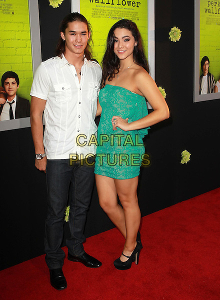 "BooBoo Stewart & Fivel Stewart.Premiere Of Summit Entertainment's ""The Perks Of Being A Wallflower"" Held At ArcLight Cinemas, Hollywood, California, USA..September 10th, 2012.full length white shirt jeans denim green strapless dress lace hand on hip sister brother siblings family .CAP/ADM/KB.©Kevan Brooks/AdMedia/Capital Pictures."