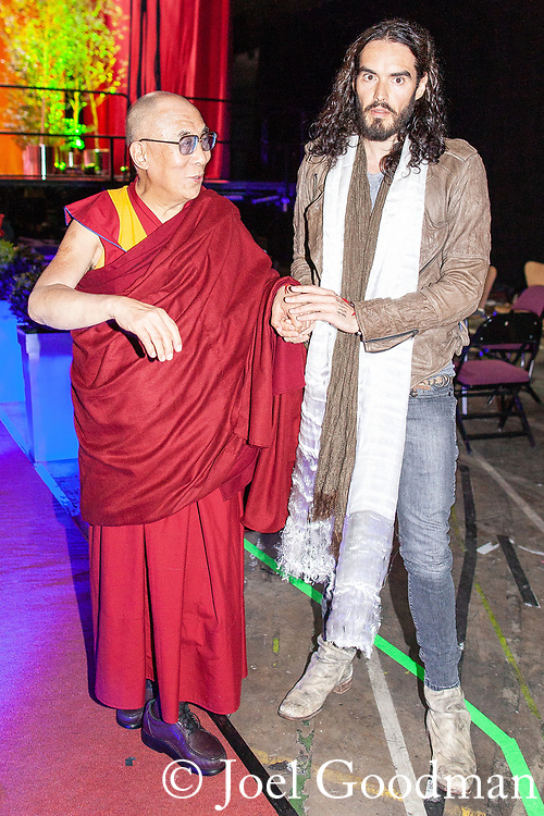 © Joel Goodman - 07973 332324 . 16/06/2012 . Manchester , UK . The DALAI LAMA and RUSSELL BRAND at the Stand Up and Be the Change youth event , hosted by the Dalai Lama during a 10 day UK tour , at the Manchester Arena . Photo credit : Joel Goodman