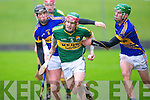Kerry's Sean Weir gets away from Tipperary's David Collins and Paddy Murphy in the Waterford Crystal cup at Austin Stack park, Tralee on Sunday.
