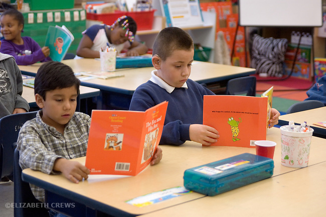 Oakland CA 2nd grade boys doing silent reading using Open Court reading materials