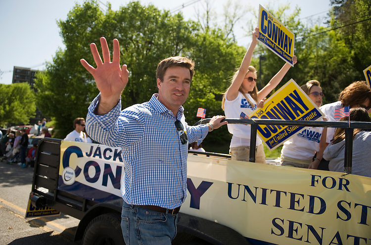 Senate candidate Jack Conway (D) walks the route of the Hillbilly Days parade while campaigning in Pikeville, Ky., April 17, 2010.