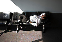 A passenger takes a moment of rest in the terminal at Southwest Airlines facilities at Love Field Airport in Dallas, Texas, Wednesday, October 27, 2010...PHOTO/ MATT NAGER