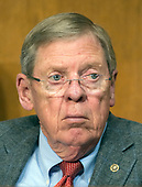 """United States Senator Johnny Isakson (Republican of Georgia) listens as Robert Lighthizer, US Trade Representative, testifies before the US Senate Committee on Finance on """"The President's 2018 Trade Policy Agenda"""" on Capitol Hill in Washington, DC on Thursday, March 22, 2018.<br /> Credit: Ron Sachs / CNP"""