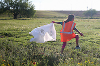Yfat Yossifor / Standard-Times<br /> Lauren McLane, 10, heads out to clean up trash during the Trash and Treasure Hunt Saturday, April 23, as part of Don&rsquo;t Mess with Texas 30 year celebration event.