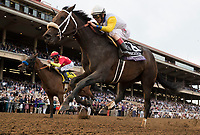 DEL MAR, CA - NOVEMBER 03: Forever Unbridled #6, ridden by John Velazquez, sprints along the home stretch while trying to hold off Abel Tasman #4, ridden by Mike Smith, on Day 1 of the 2017 Breeders' Cup World Championships at Del Mar Thoroughbred Club on November 3, 2017 in Del Mar, California. (Photo by Alex Evers/Eclipse Sportswire/Breeders Cup)
