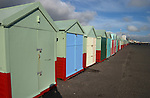 A line of beach huts, Worthing, England