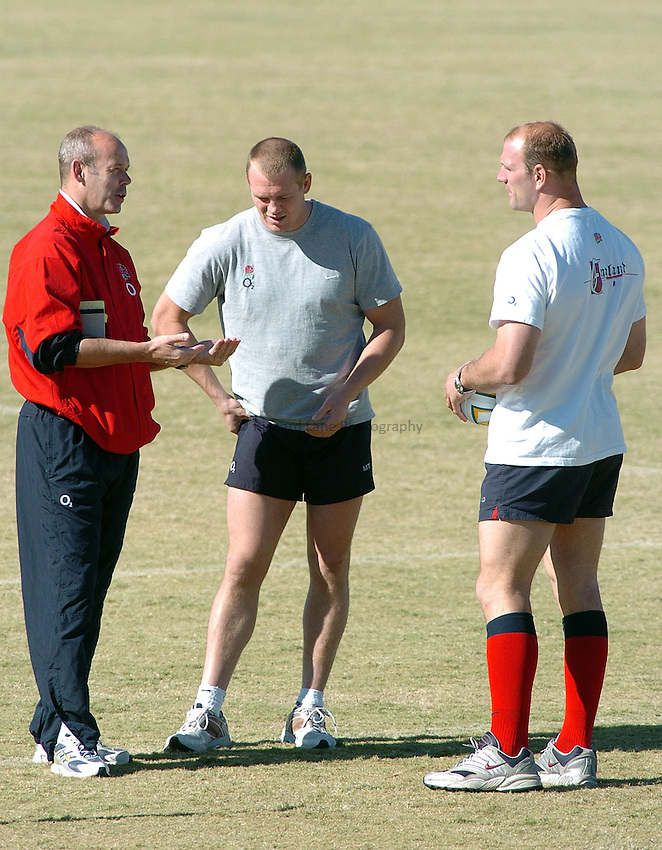 Photo: Steve Holland..England training in Brisbane. 23/06/2004..Clive Woodward, L, Mike Tindall, Lawrence Dallaglio..