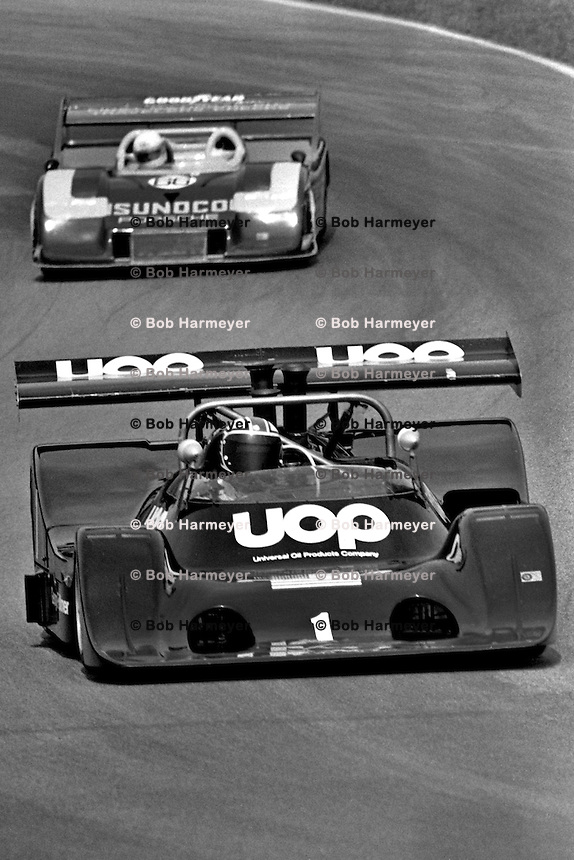 LEXINGTON, OH - AUGUST 11: George Follmer drives the Phoenix Racing Organizations, Inc. Shadow DN4 Chevrolet ahead of Brian Redman in Roger Penske's Porsche 917/30 003 during the Buckeye Cup SCCA Can-Am race at the Mid-Ohio Sports Car Course near Lexington, Ohio, on August 11, 1974.