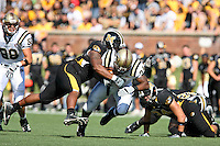 MU defensive tackle Evander (Ziggy) Hood tackles Western Michigan Broncos running back Mark Bonds as he picks up five yards during the second half at Memorial Stadium in Columbia, Missouri on September 15, 2007. The Tigers won 52-24.