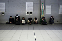 People stranded in Shinagawa station. Shinagawa, Tokyo, 11 March 2011. After a huge earthquake in north-east Japan several million people in Tokyo struggle to return home.