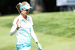 Lexi Thompson acknowledge the fans on the 11th fairway at the LPGA Championship 2014 Sponsored By Wegmans at Monroe Golf Club in Pittsford, New York on August 13, 2014