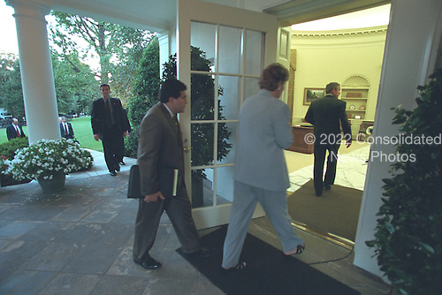 Counselor Karen Hughes and Counsel Alberto Gonzales follow United States President George W. Bush into the Oval Office of the White House in Washington, D.C. on Tuesday, September 11, 2001..Mandatory Credit: Paul Morse - White House via CNP.