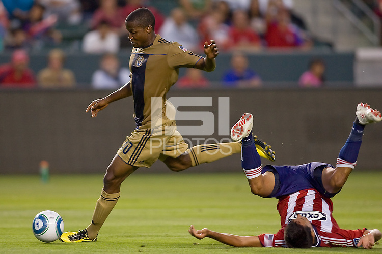 Philadelphia Union forward Danny Mwanga (10) moves past upside down CD Chivas USA midfielder Ante Jazic (6) on his way to scoring a goal. The Philadelphia Union and CD Chivas USA played to 1-1 draw at Home Depot Center stadium in Carson, California on Saturday evening July 3, 2010..