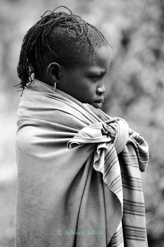 A Turkana girl in a traditional village nr. Kakuma, Northern Kenya.