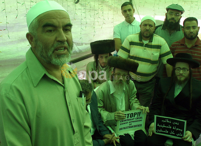 Sheikh Raed Salah (L), head of the Arab-Israeli Islamic Movement, meet with members of Neturei Karta, Ultra-Orthodox Jews who oppose Zionism in East Jerusalem on October 06, 2009. Jerusalem experienced a second day of clashes between Israeli border police and Palestinian youths. Israeli authorities continued to limit access to the mosque compound in the Old City to Muslim men aged 50 and over, after Sunday's clashes in which seven Palestinian protesters were injured and three arrested . Photo by Mahfuz Abu Turk