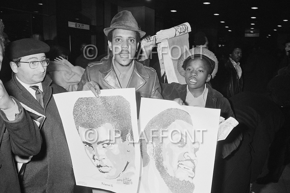 March 8 1971, Manhattan, New York City, New York State, USA --- Boxing Fans Holding Posters Outside Madison Square Garden --- Image by © JP Laffont