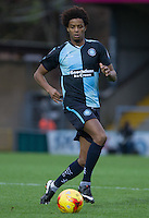 Sido Jombati of Wycombe Wanderers on the ball during the Sky Bet League 2 match between Wycombe Wanderers and Portsmouth at Adams Park, High Wycombe, England on 28 November 2015. Photo by Andy Rowland.