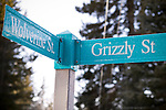Signpost in the winter on the corner of Wolverine and Grizzly Street in Banff, Alberta, Canada.