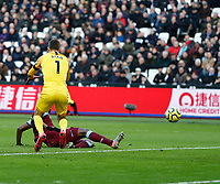 1st February 2020; London Stadium, London, England; English Premier League Football, West Ham United versus Brighton and Hove Albion; Issa Diop of West Ham United slides in to score the first goal of the game in the 30th minute