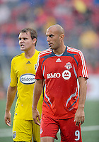 Danny Dichio (9) and Chad Marshall (14) in between action at  BMO Field on Saturday September 13, 2008. .The game ended in a 1-1 draw.
