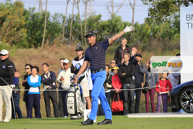 Robert Karlsson (SWE) tees off the 17th tee during Sunday's Final Round of the 2014 BMW Masters held at Lake Malaren, Shanghai, China. 2nd November 2014.<br /> Picture: Eoin Clarke www.golffile.ie