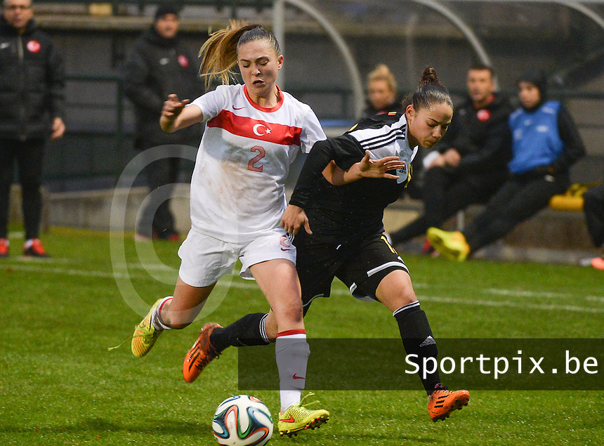 20141126 - TUBIZE , BELGIUM : Belgian Lola Wajnblum (right) pictured in a duel with Turkish Berna Yeniceri (left) during the Friendly female soccer match between Women under 19 / 21  teams of  Belgium and Turkey .Wednesday 26th November 2014 . PHOTO DAVID CATRY