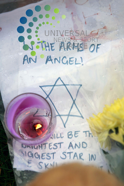 Members of the public lay flowers and candles in Ferry Gait Crescent:<br />