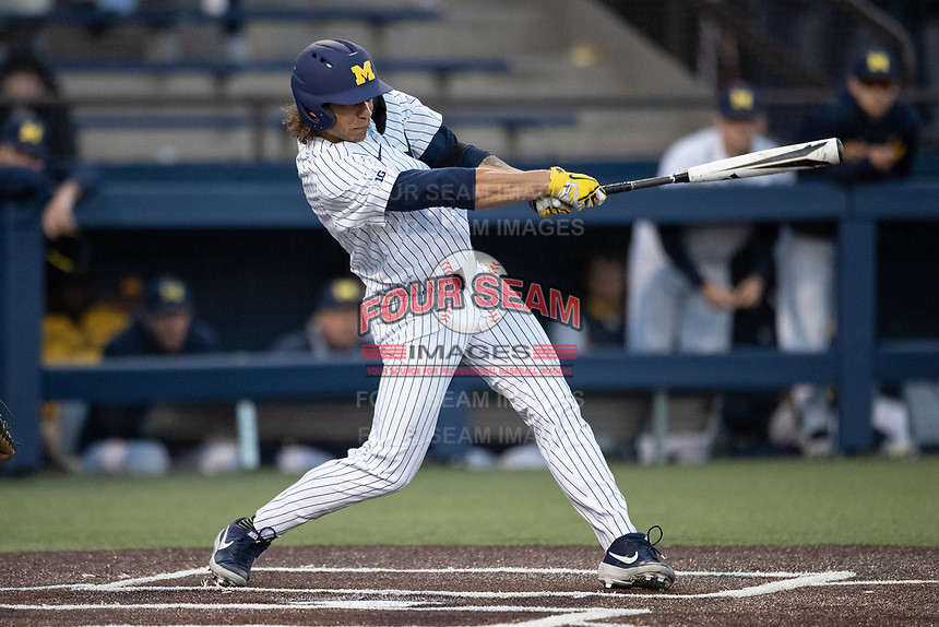 Michigan Wolverines outfielder Jordan Brewer (22) swings the bat during the NCAA baseball game against the Eastern Michigan Eagles on May 8, 2019 at Ray Fisher Stadium in Ann Arbor, Michigan. Michigan defeated Eastern Michigan 10-1. (Andrew Woolley/Four Seam Images)