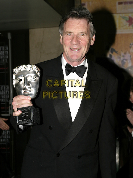 MICHAEL PALIN.Leaving the After Party for the Pioneer British Academy Television Awards (TV BAFTA's), Grosvenor House Hotel, .London, April 17th 2005..half length award trophy.Ref: AH.www.capitalpictures.com.sales@capitalpictures.com.©Adam Houghton/Capital Pictures.